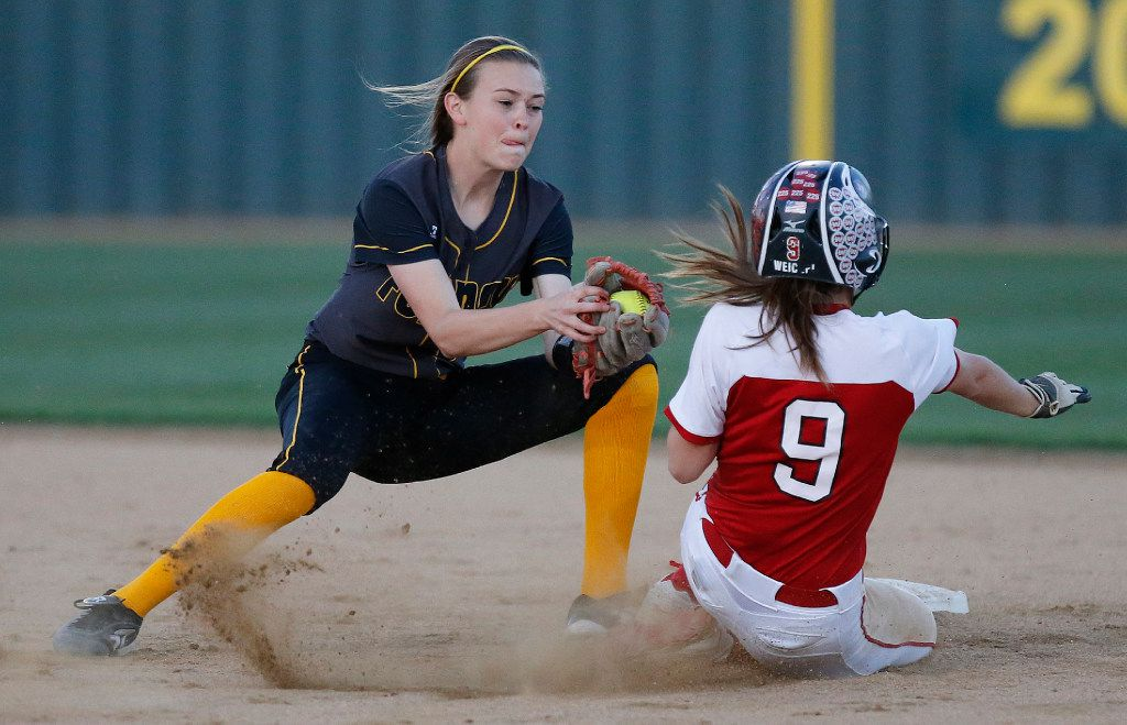 Forney shortstop Caleigh Cross (23) was unable to get the tag down in time to get Lovejoy shortstop Emily Weichel (9) stealing second base Friday. Forney beat Lovejoy 9-2 in a matchup of area-ranked teams. (Photo by Stewart F. House)
