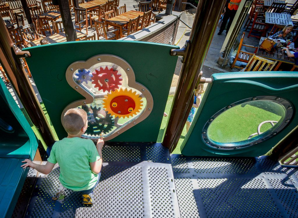 With parents nearby, a child plays on the playground equipment at Central Market on Hulen Street in Fort Worth, Texas on May 6, 2018. (Robert W. Hart/Special Contributor)