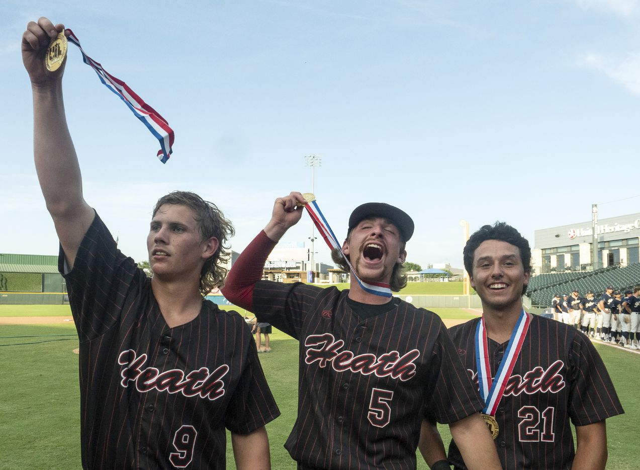 Rockwall-Heath Kevin Bazzell, (9), Karson Krowka, (5), and Zach Rike, (21),  celebrate with their UIL gold medals after defeating Keller in the 2021 UIL 6A state baseball final held, Saturday, June 12, 2021, in Round Rock, Texas.  Rockwall-Heath defeated Keller 4-3.   (Rodolfo Gonzalez/Special Contributor)