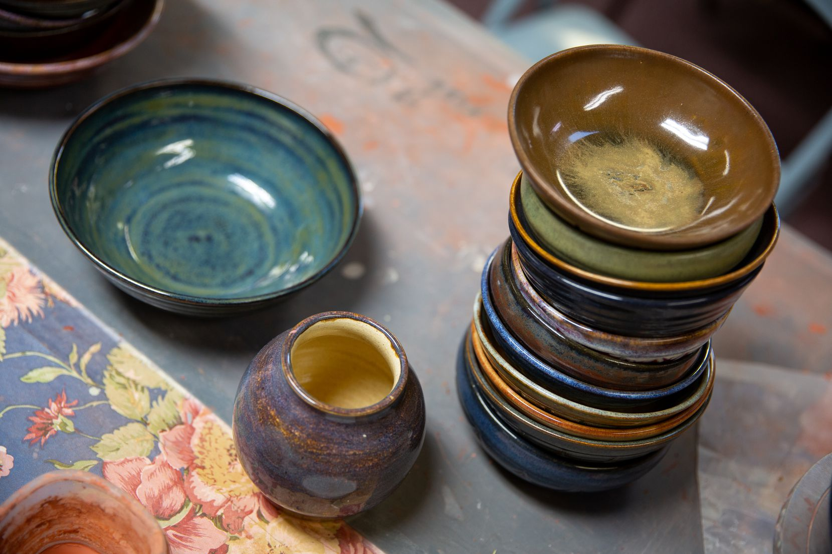 A stack of completed bowls sits in Bill Reed's upstairs home studio in Denton. Reed took up the hobby 20 years ago and has become a prolific bowl maker.