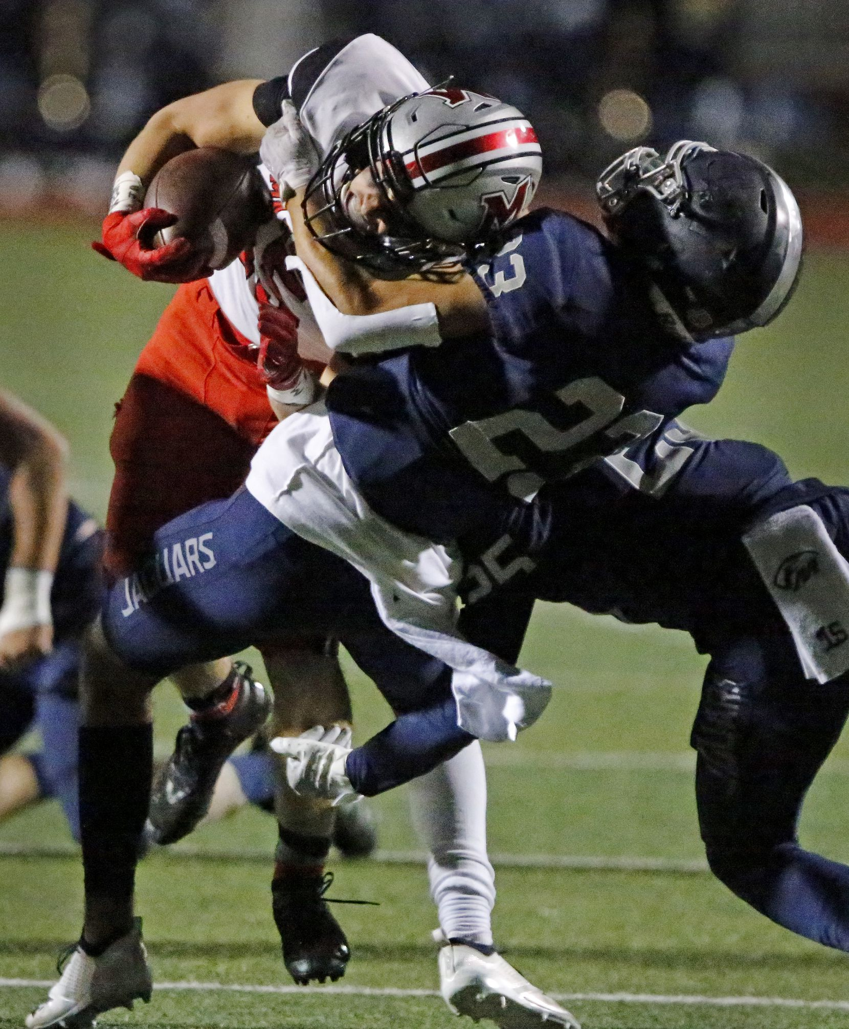Flower Mound Marcus running back Gabe Espinoza (15) is tackled by Flower Mound High School safety Chase McCall (23) during the first half as Flower Mound High School hosted Flower Mound Marcus High School at Neal E. Wilson Jaguar Stadium on Friday night, October 23, 2020. (Stewart F. House/Special Contributor)