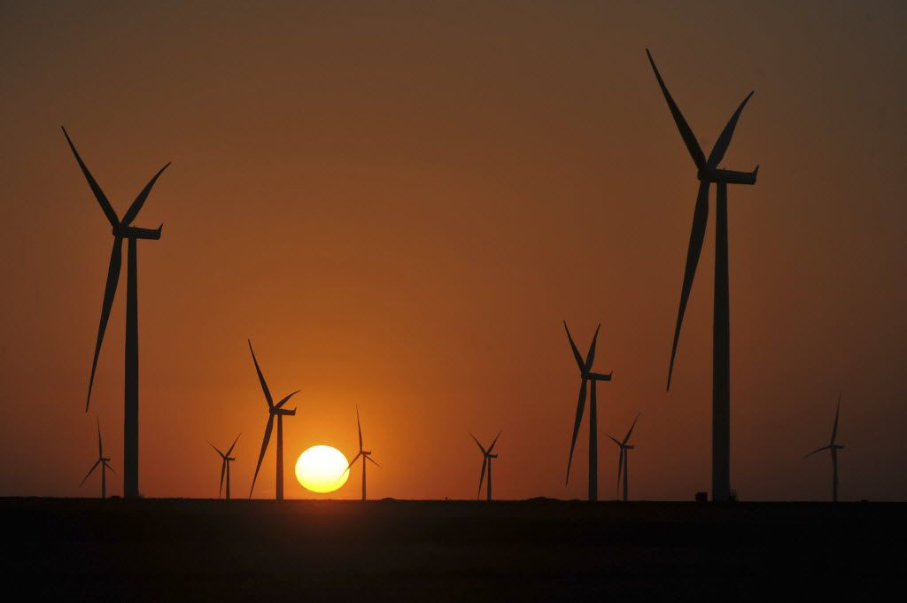 Turbines turn slowly at sunset at a wind farm near the town of Panhandle, Texas, July 10, 2014. Texas is close to completing a sprawling, $7 billion network of high-voltage power lines that will connect this area ideally suited for wind power to urban markets. (David Bowser/The New York Times)