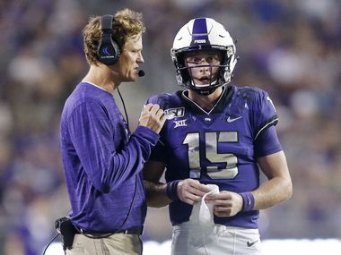 TCU Co-Offensive Coordinator Sonny Cumbie (left) confers with TCU Horned Frogs quarterback Max Duggan (15) during the second quarter against the Arkansas-Pine Bluff Golden Lions at Amon G. Carter Stadium in Fort Worth Texas, Saturday, August 31, 2019.