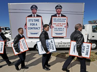 In this August 2019 photo, Southwest Airlines pilots wrapped up their picket in protest over a new labor contract at Mockingbird Lane and Cedar Springs Road in Dallas.