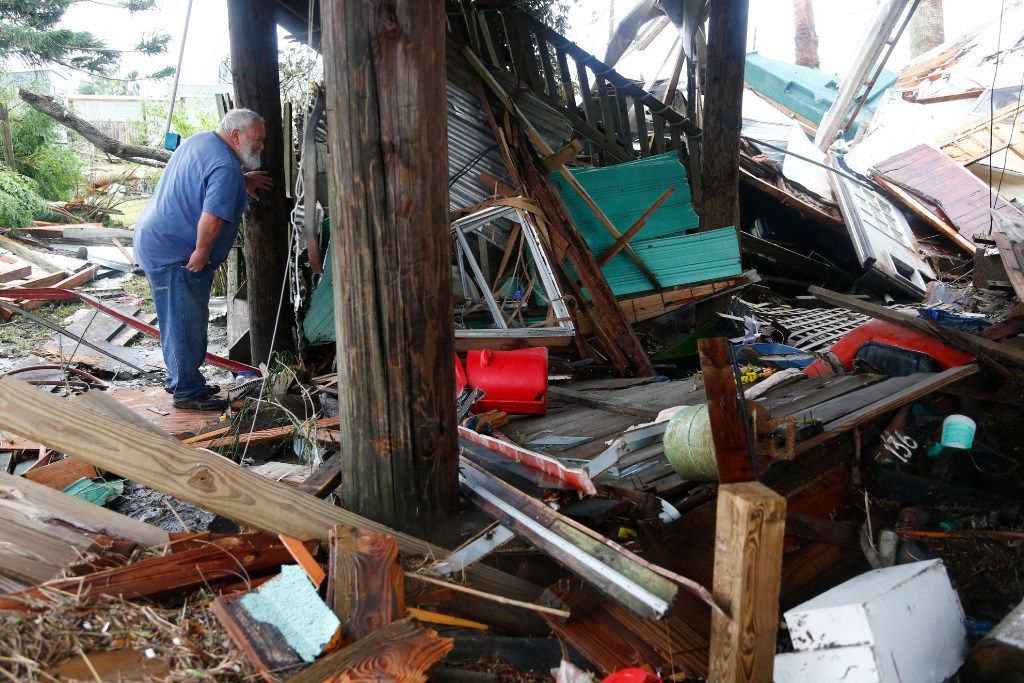 Bill Rogers looks at what's left of his property after Hurricane Harvey destroyed his house in Port Aransas.