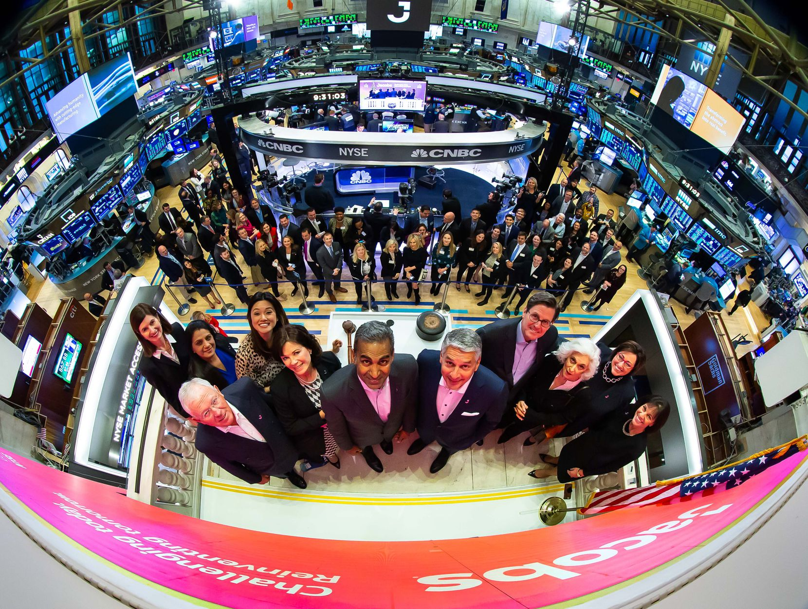 """Steve Demetriou (center right), CEO of Jacobs Engineering Group, with his leadership team, celebrated 30 years of being a public company on the New York Stock Exchange and its new ticker symbol, the single letter """"J,"""" on Feb. 4, 2020."""