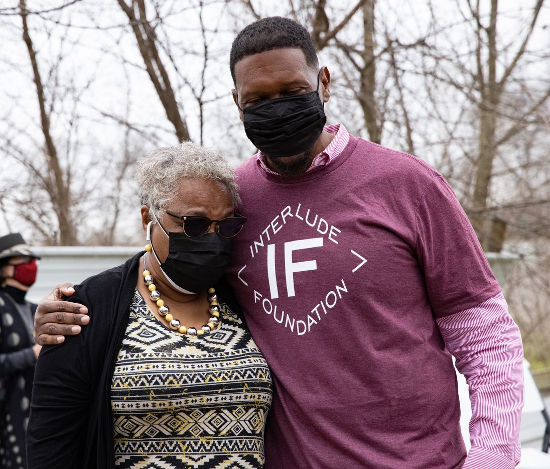 Quincy Roberts, the contractor who moved Shingle Mountain, hugs Marsha Jackson after a concert outside of her home in Dallas on Friday, Feb. 26, 2021. (Juan Figueroa/ The Dallas Morning News)