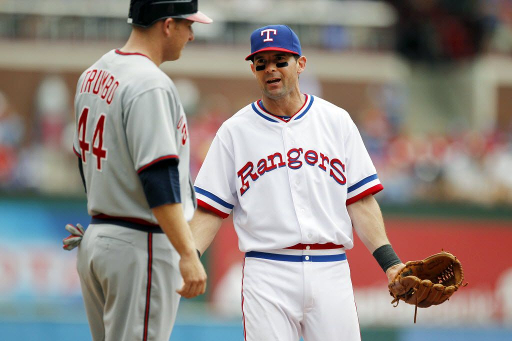 Texas third baseman Michael Young is pictured with Angels base runner Mark Trumbo during the Texas Rangers and the Los Angeles Angels major league baseball game at Rangers Ballpark in Arlington on Saturday, May 12, 2012.  (Louis DeLuca/The Dallas Morning News)