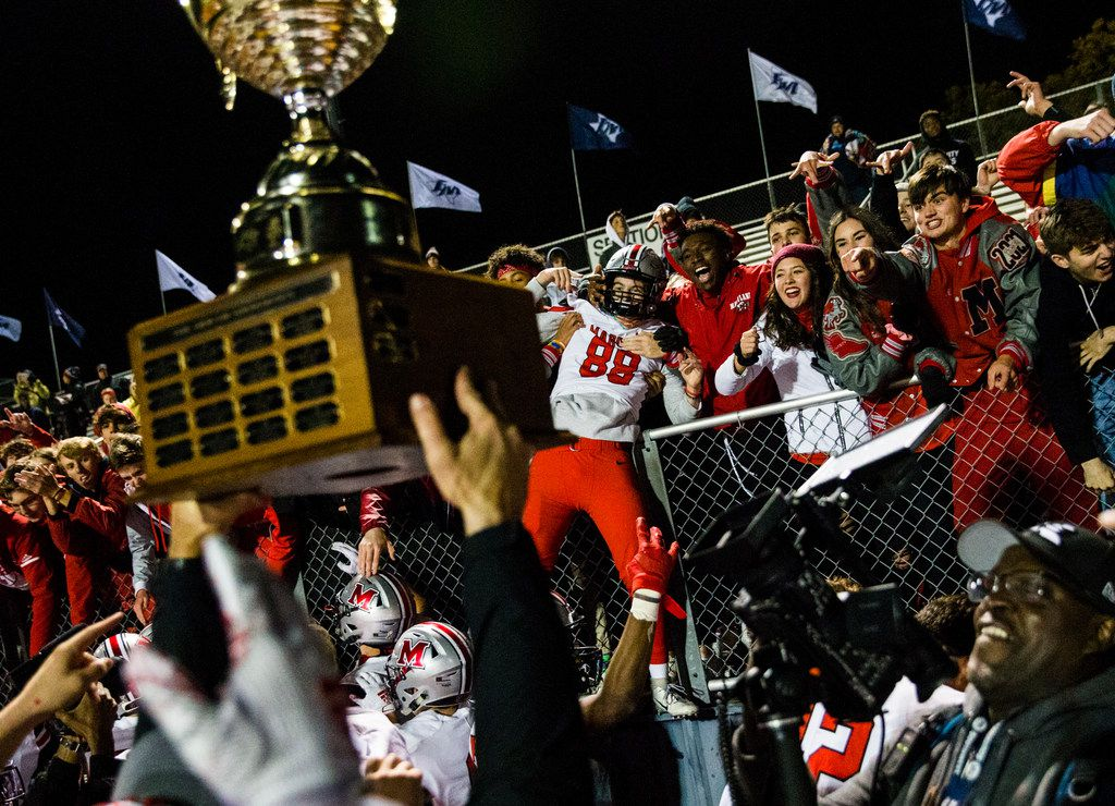 Flower Mound Marcus defensive lineman Stone Raunam (88) celebrates with fans while his teammates hoist the Mound Showdown trophy after a 34-31 win over Flower Mound on Friday, October 25, 2019 at Neil E. Wilson Stadium in Flower Mound.