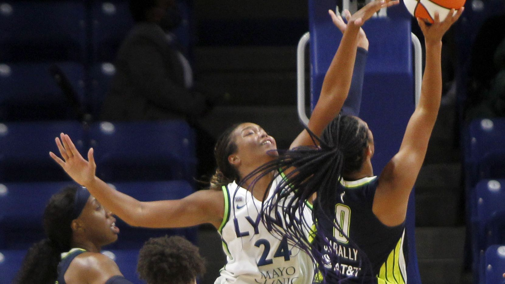 Dallas Wings forward Satou Sabally (0) drives to the basket and draws a foul by Minnesota Lynx forward Napheesa Collier (24) during 2nd quarter action. The two teams played their WNBA game at College Park Center on the campus of the University of Arlington on June 17, 2021