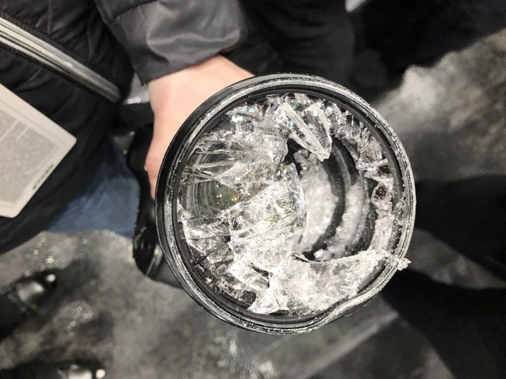 Ashley Landis, staff visual journalist at The Dallas Morning News, holds her broken 70-200mm f2.8 lens after it was struck by a puck during the second period of the Dallas Stars vs. Buffalo Sabres game at American Airlines Center in Dallas on Jan. 16, 2020.