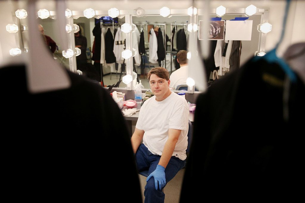 Ben Bryant, who plays Nigel Grouse, sits for a photograph before demonstrates the process of applying makeup and dressing for his role in A Minor Case of Murder! at the Eisemann Center in Richardson.