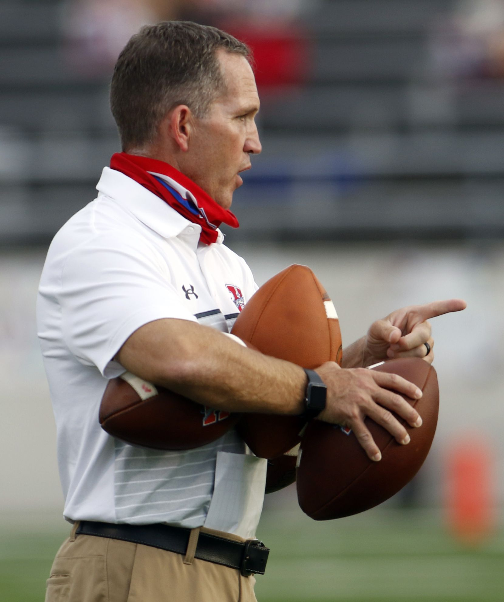 Midlothian Heritage head football coach Lee Wigginton makes a point while working with his players during team warm-ups prior to the opening kickoff of their game against Lindale. The two teams played their Class 4A football game at Midlothian ISD Multipurpose Stadium in Midlothian on September 4, 2020. (Steve Hamm/ Special Contributor)