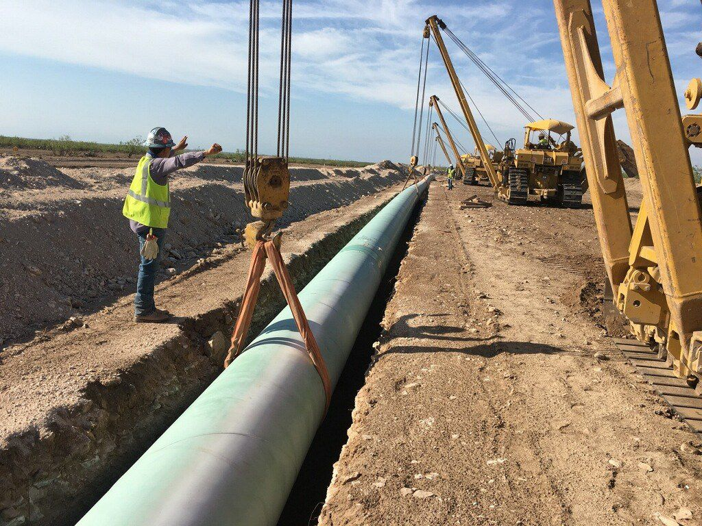 A shortage of crude oil and natural gas pipeline capacity is squeezing Permian Basin drillers. Kinder Morgan's $1.75 billion Gulf Coast Express natural gas pipeline -- seen here in June 2018 in Midland County -- is under construction and will link the Permian Basin with the Texas Gulf Coast.
