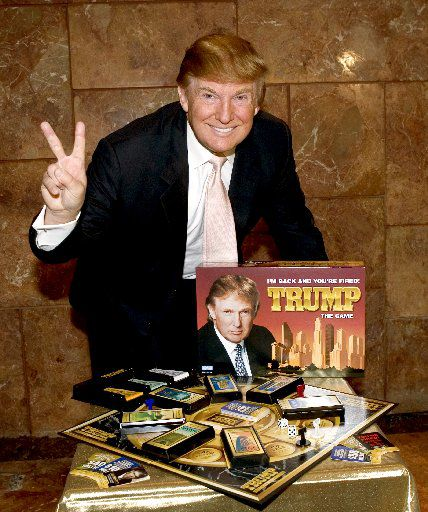 """Donald Trump launches the new board game, """"Trump the Game,"""" during a news conference at Trump Tower in New York on Aug.18, 2004. The object of the game is to live like Trump and make the most money by acquiring Trump Cards that are used to strike deals and buy big-ticket items, such as resorts and office buildings. (AP Photo/Newscast, Jim Sulley)"""