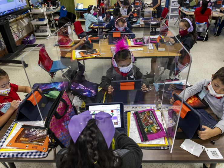 Kindergarten students work independently in Michelle Davis' class at F.P. Caillet Elementary in Dallas on Wednesday, May 5, 2021. (Lynda M. González/The Dallas Morning News)