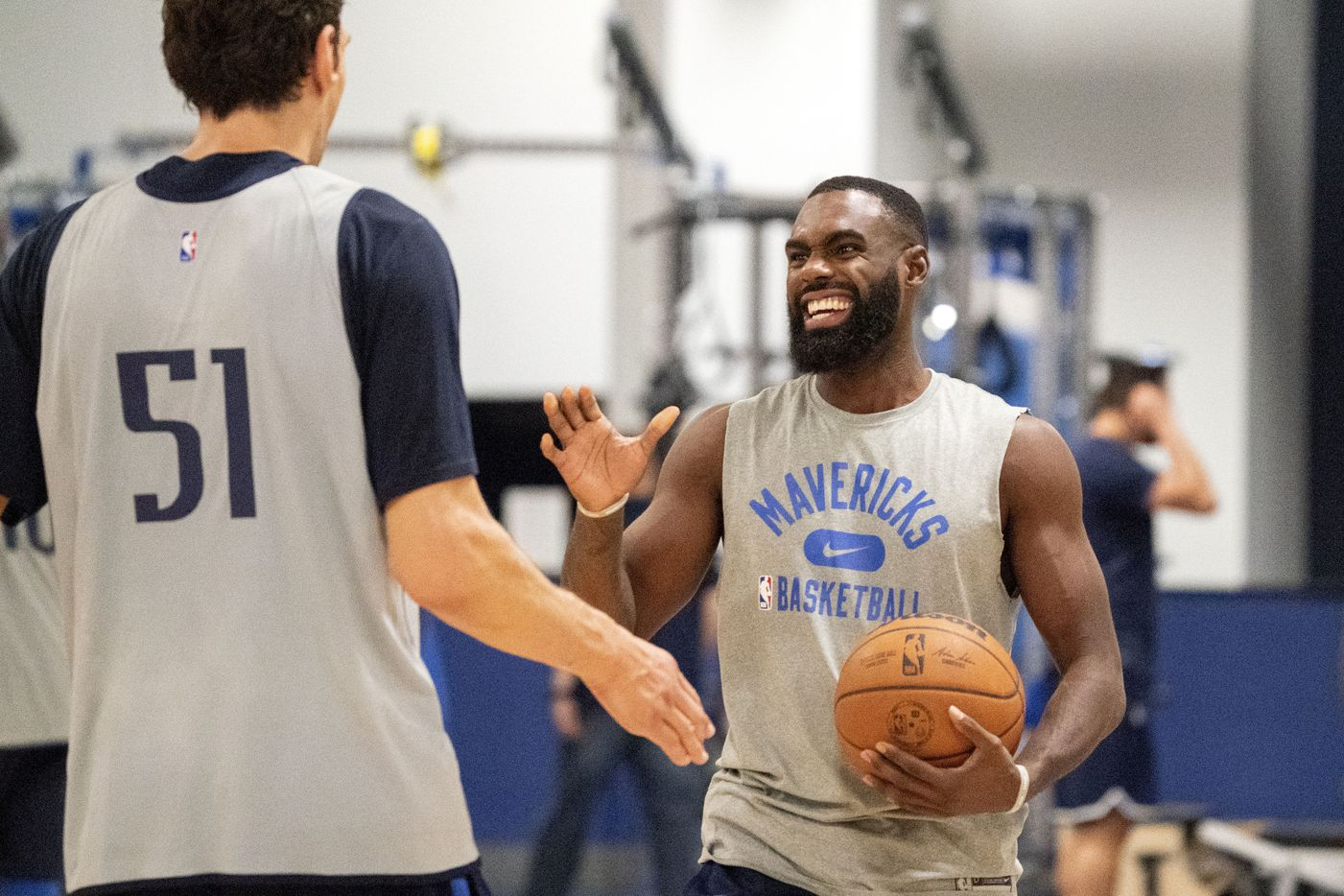 Dallas Mavericks guard Tim Hardaway Jr. laughs with center Boban Marjanović during a training camp practice Wednesday, September 29, 2021 at the Dallas Mavericks Training Center in Dallas. (Jeffrey McWhorter/Special Contributor)