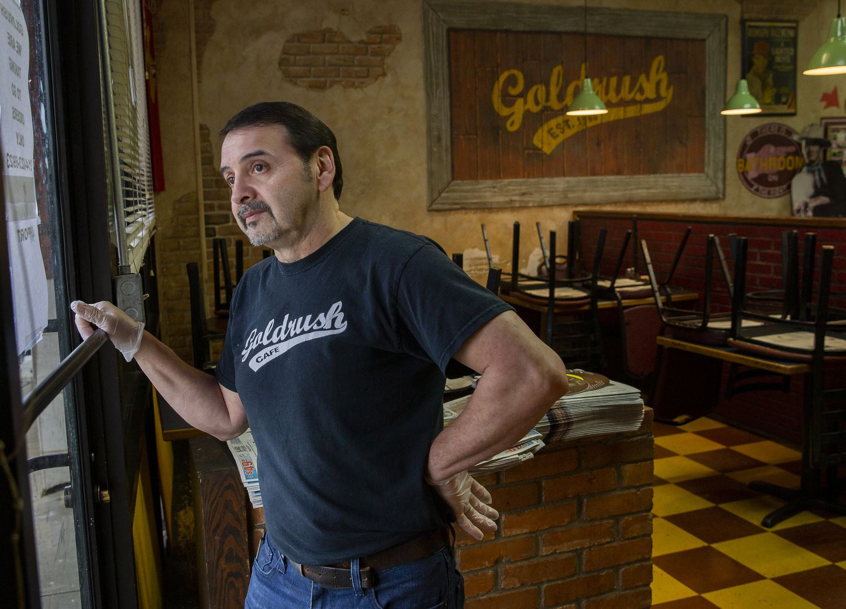 Goldrush Cafe owner George Sanchez waited for customers on March 16 in Dallas. Restaurants' business has cratered during the coronavirus pandemic.