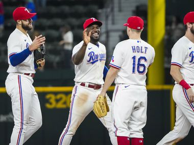 From left, Texas Rangers  right fielder Joey Gallo, center fielder Adolis Garcia, third baseman Brock Holt and left fielder David Dahl celebrate after the final out of a victory over the Detroit Tigers at Globe Life Field on Tuesday, July 6, 2021.