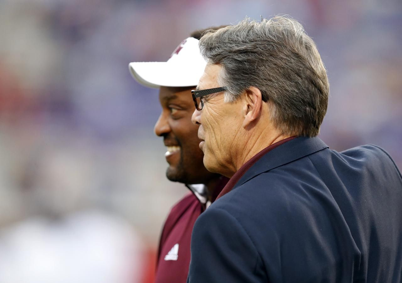 Rick Perry, an Aggie, has caught some A&M games when he's not home in Round Top.