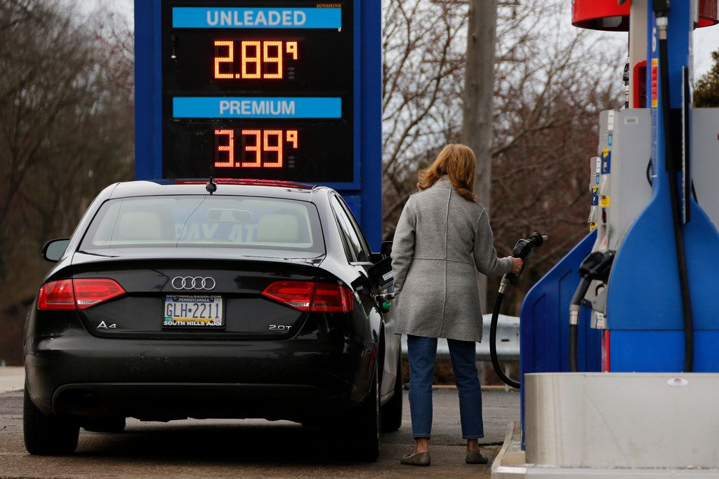 A motorist pumps gas in Bethel Park, Pa.