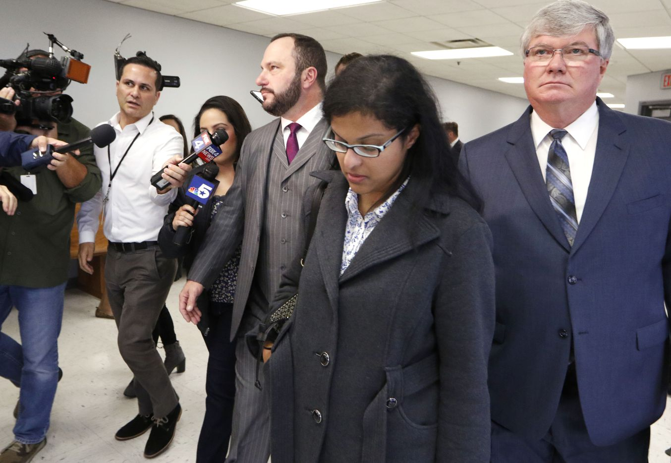 Sini Mathews, foreground, mother of Sherin Mathews, leaves Judge Cheryl Lee Shannon's courtroom where she learned that her biological child, a 4-year-old girl, will remain in foster care for another three weeks while Wesley Mathews looks for a civil attorney. The custody hearing was held at the Henry Wade Juvenile Justice Building on Monday, November 13, 2017. Wesley and Sini Mathews first appeared in court on Oct. 23 to try to regain custody of the biological daughter who was taken into Child Protective Services custody after Sherin was reported missing Oct. 7, 2017. The Judge has scheduled a new hearing for November 29, 2017. (David Woo/The Dallas Morning News)