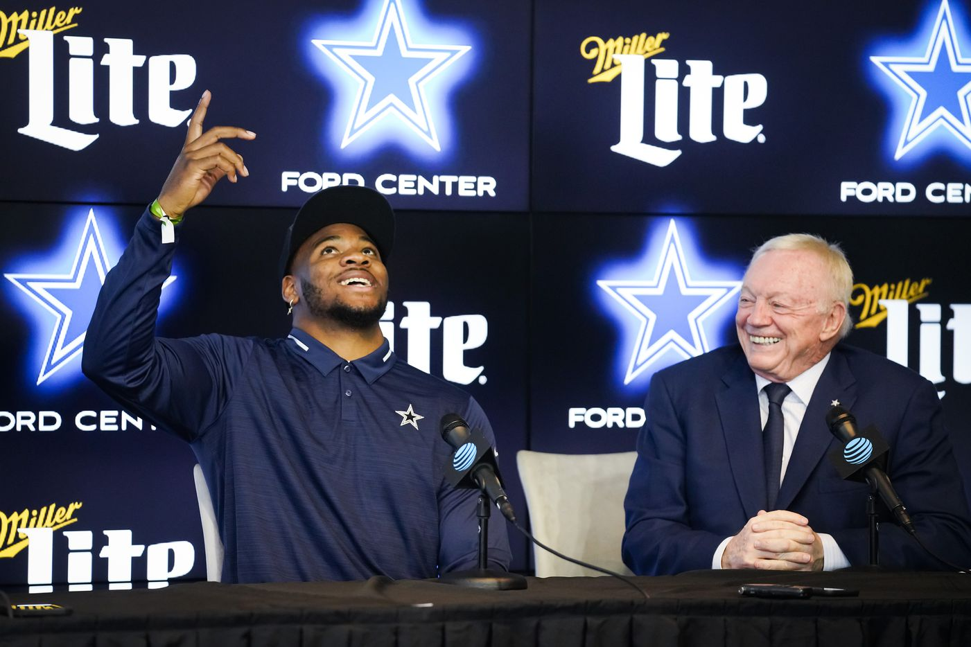 Dallas Cowboys first-round draft pick Micah Parsons points upward as he answers a question next to team owner Jerry Jones during a press conference introducing the linebacker from Penn State at The Star on Friday, April 30, 2021, in Frisco. (Smiley N. Pool/The Dallas Morning News)