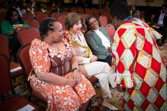 Former first lady Laura Bush talks to South African first lady Nompumelelo Ntuli Zuma (left), Ethopian first lady Roman Tesfaye (second from right) and another participant.