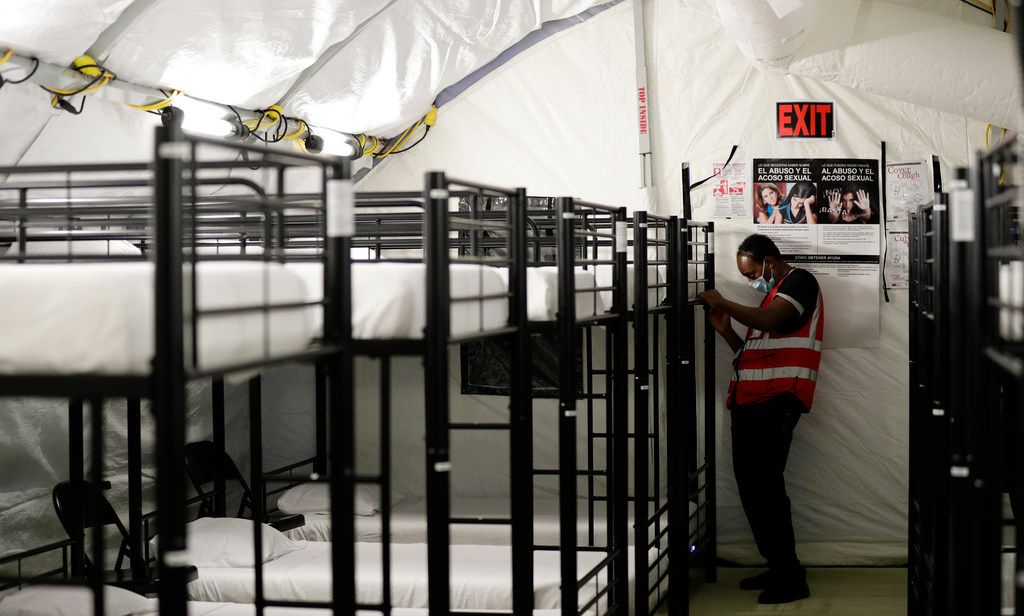 A staff member worked in the infirmary, a series of tents, at the U.S. government's newest holding center for migrant children in Carrizo Springs, Texas, this week..