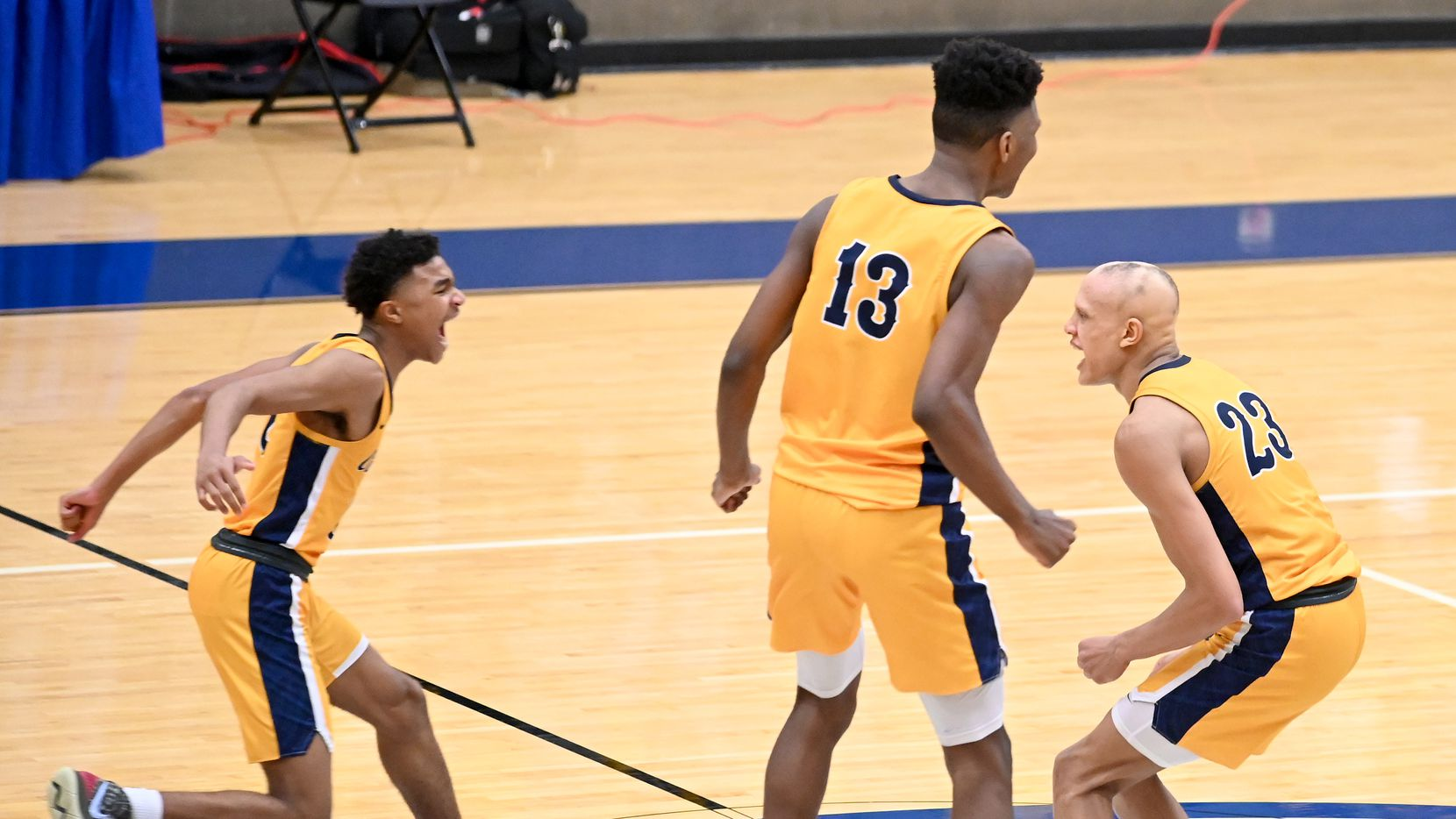 From left, Faith Family's Dallas Hobbs, Mekhi Collins (13) and Jordan Walsh celebrate their win of a Class 4A Region II final boys playoff basketball game between Dallas Carter and Oak Cliff Faith Family, Friday, March 5, 2021, in Grand Prairie, Texas. (Matt Strasen/Special Contributor)