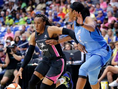 Dallas Wings forward Kayla Thornton (6) drives around Atlanta Dream center Alaina Coates (81) during the second half at College Park Center in Arlington, Texas, Sunday, August 25, 2019. Despite their comeback in the fourth quarter, the Wings fell to the Dream, 77-73.