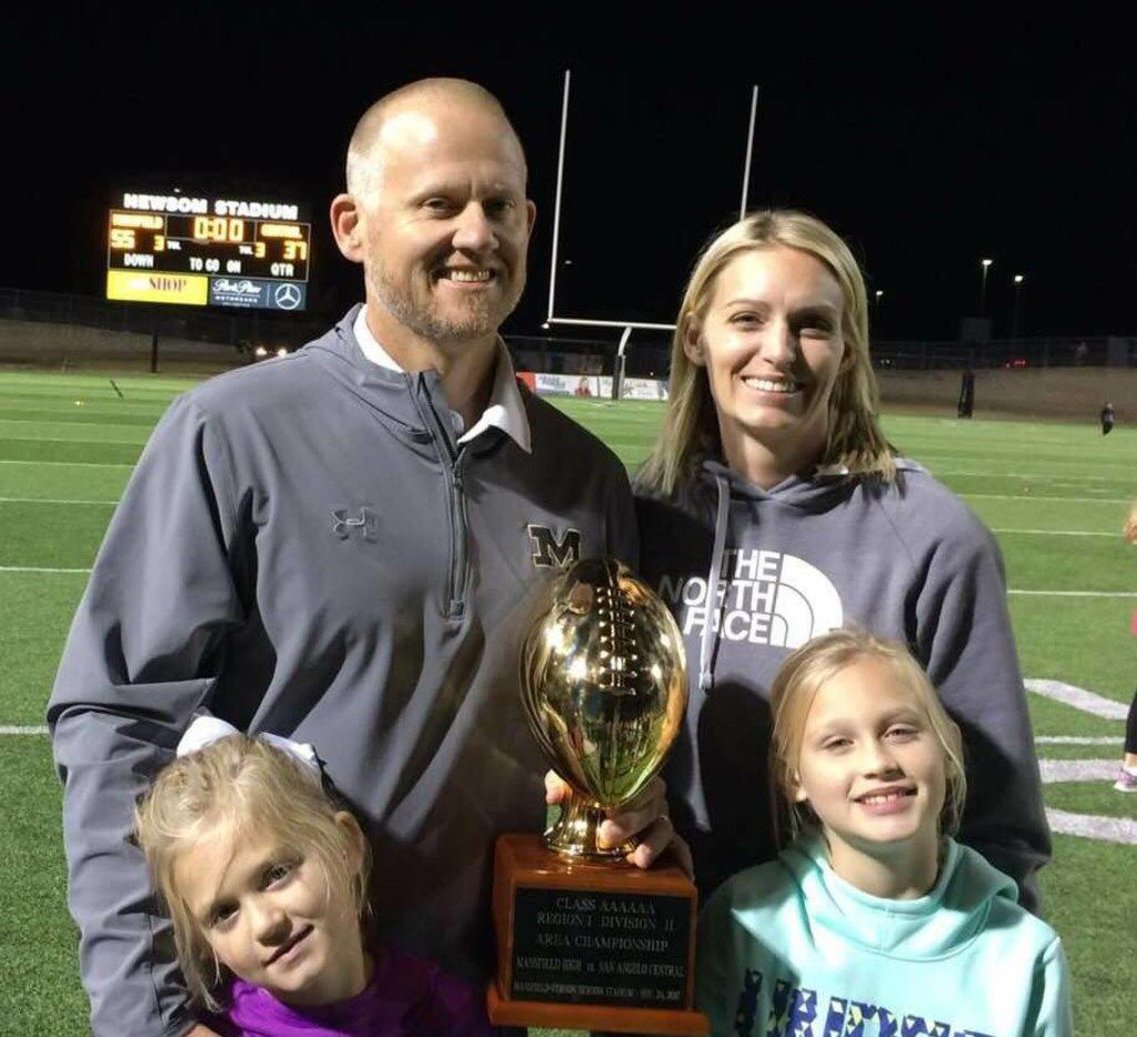 Mansfield football coach Daniel Maberry with his wife, Cami, and their two daughters.