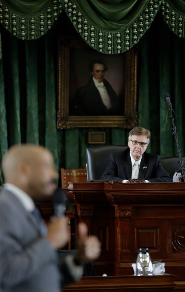 "Texas Lt. Gov. Dan Patrick, right, listen to Sen. Borris Miles, D-Houston, during debate over a ""bathroom bill"" in the Senate Chamber, Tuesday, July 25, 2017, in Austin, Texas. The Texas Senate has revived a bill mandating transgender Texans use public restrooms corresponding to their birth-certificate genders. (AP Photo/Eric Gay)"