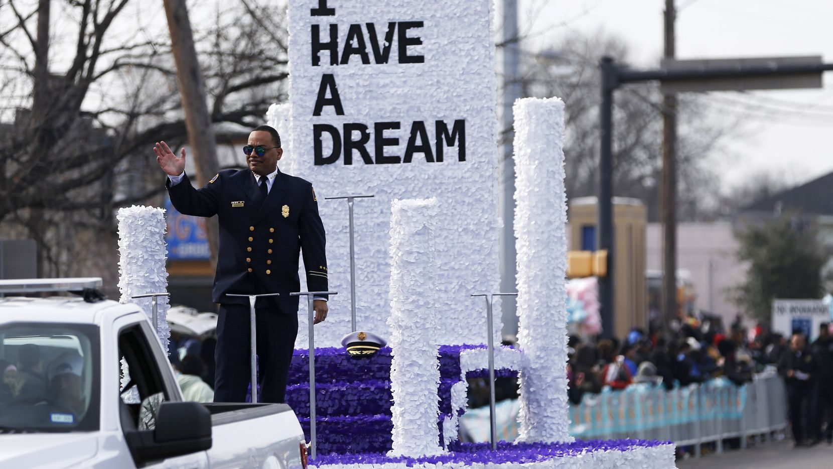 Dallas Fire-Rescue Chief Dominique Artis, grand marshall waves to the people as they make their way down Martin Luther King Jr. Blvd during the 37th Annual MLK Parade in Dallas on Jan. 21, 2019.