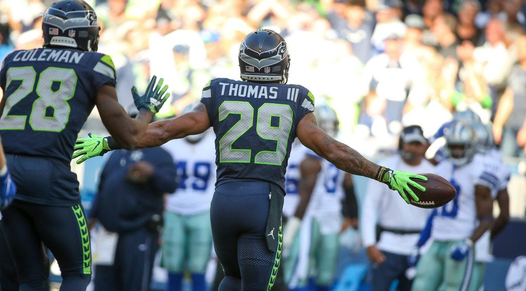 FILE - Seahawks safety Earl Thomas (29) runs toward the Cowboys bench after intercepting a Dak Prescott pass in the second half of a game on Sunday, Sept. 23, 2018, at CenturyLink Field in Seattle. (Shaban Athuman/The Dallas Morning News)