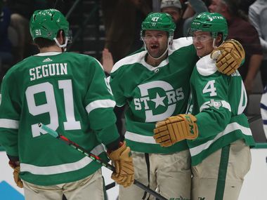 DALLAS, TEXAS - JANUARY 29:  (L-R) Tyler Seguin #91, Alexander Radulov #47 and Miro Heiskanen #4 of the Dallas Stars celebrate a goal against the Toronto Maple Leafs in the third period at American Airlines Center on January 29, 2020 in Dallas, Texas. (Photo by Ronald Martinez/Getty Images)