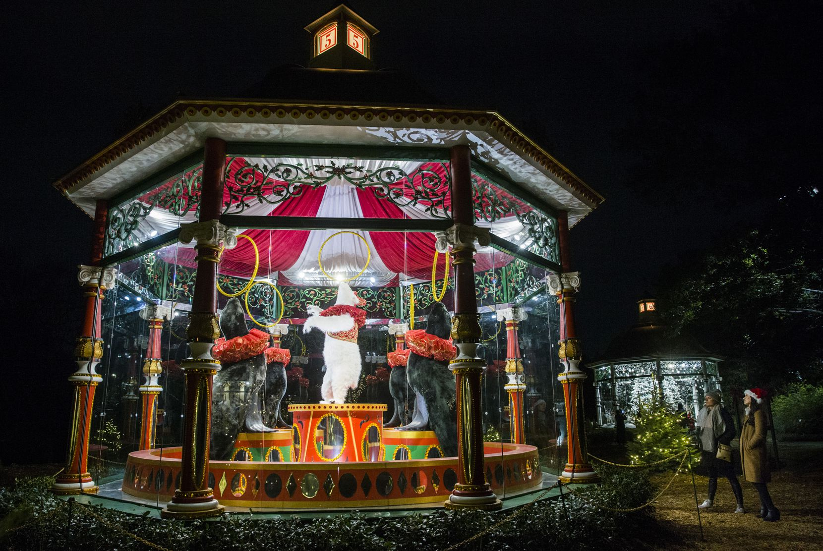 """The 12 Days of Christmas"" exhibit is back at the Dallas Arboretum, featuring 12 glass-encased gazebos that depict scenes from each verse of the holiday carol."