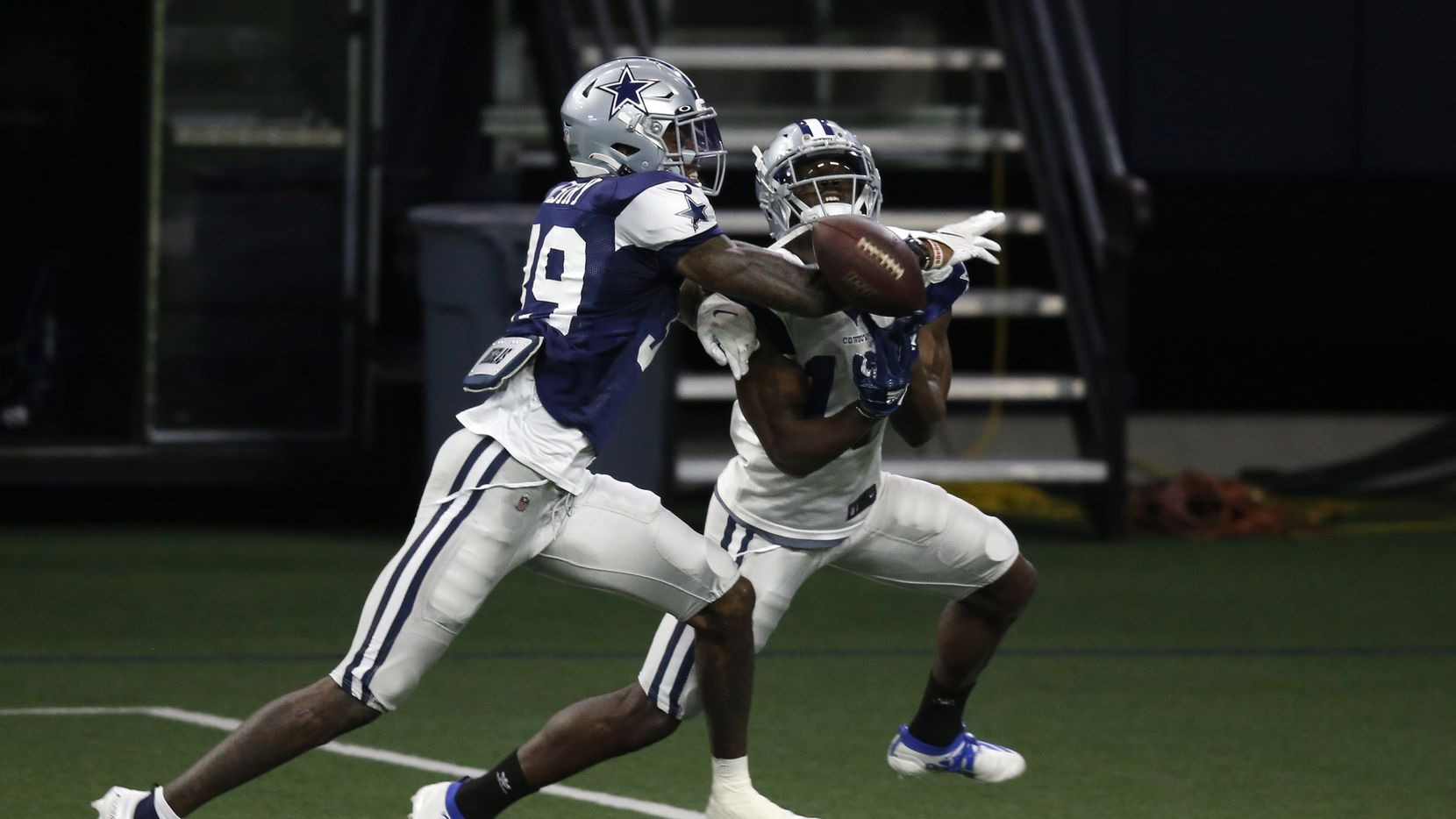 FILE - Cowboys cornerback Chris Westry (39) deflects a pass intended for wide receiver Michael Gallup (13) during training camp at The Star in Frisco on Friday, Aug. 28, 2020.