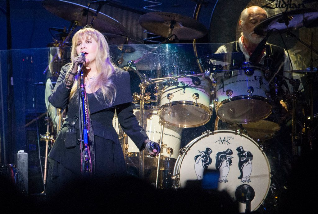"""Fleetwood Mac singer Stevie Nicks and drummer Mick Fleetwood perform """"Dreams"""" at the American Airlines Center in Dallas on Feb. 7, 2019."""