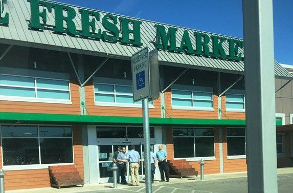 Employees standing outside The Fresh Market in Lakewood at Gaston Ave. and Garland Road on Tuesday, May 3, 2016. (Photo by Robert Metts)