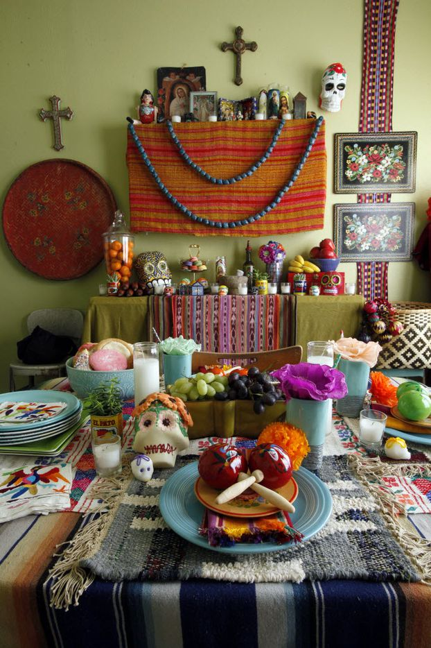 An altar for Dia de los Muertos inside the home of  Melissa Love-Tristan, as part of her Halloween and Dia De Los Muertos decor, on Monday, Oct. 26, 2015 in Dallas. The untraditional altar does not include photographs or interests from a deceased member of the family, but according to Love-Tristan the altar does contain personal belongings from her and her husband's grandparents. Ben Torres/Special Contributor
