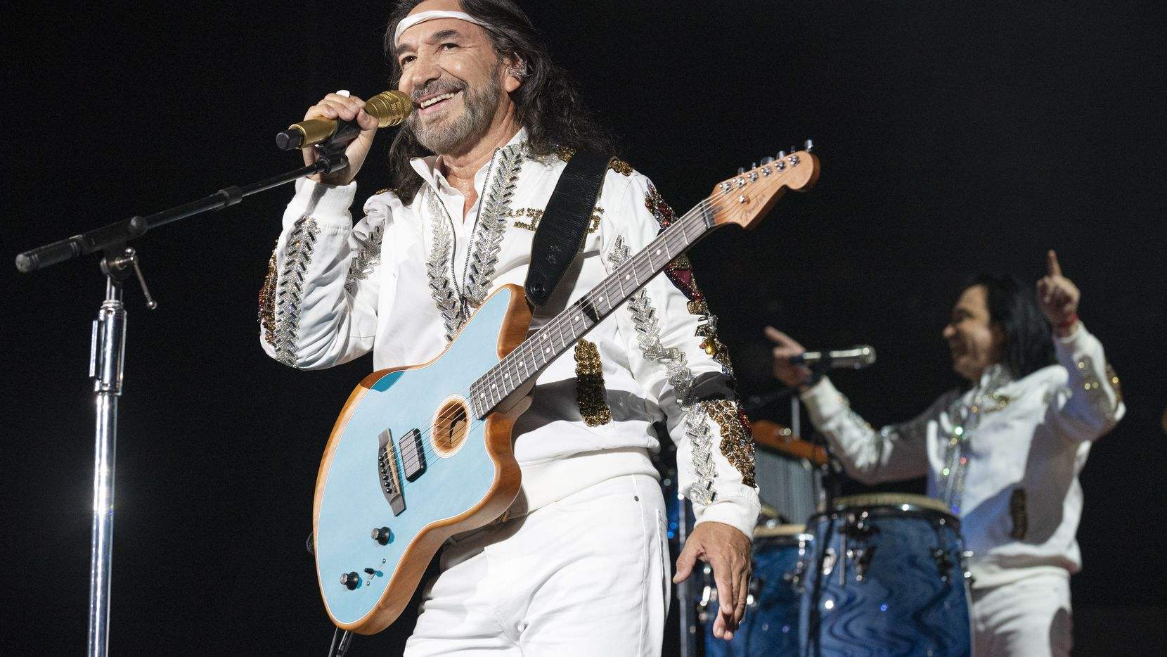 Los Bukis performed in concert at the AT&T Stadium in Arlington on Wednesday.