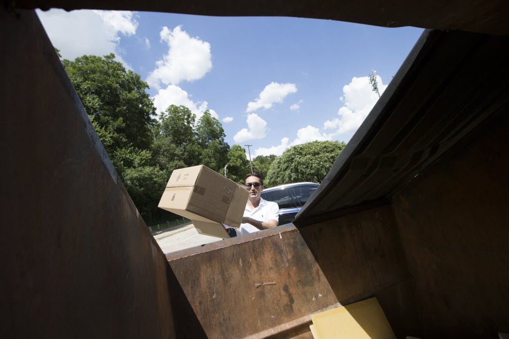 José Cavazos, of Dallas, tosses recyclable waste in to a Dallas Sanitation Services Department recycling dumpster at the Reverchon Park location on Aug. 6, 2016 in Dallas, Texas. (Ting Shen/The Dallas Morning News)