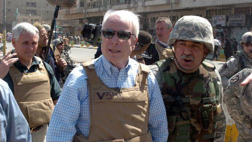 A picture released by the U.S. military April 3, 2007, shows U.S. Sen. John McCain visiting Baghdad's Shorja market.