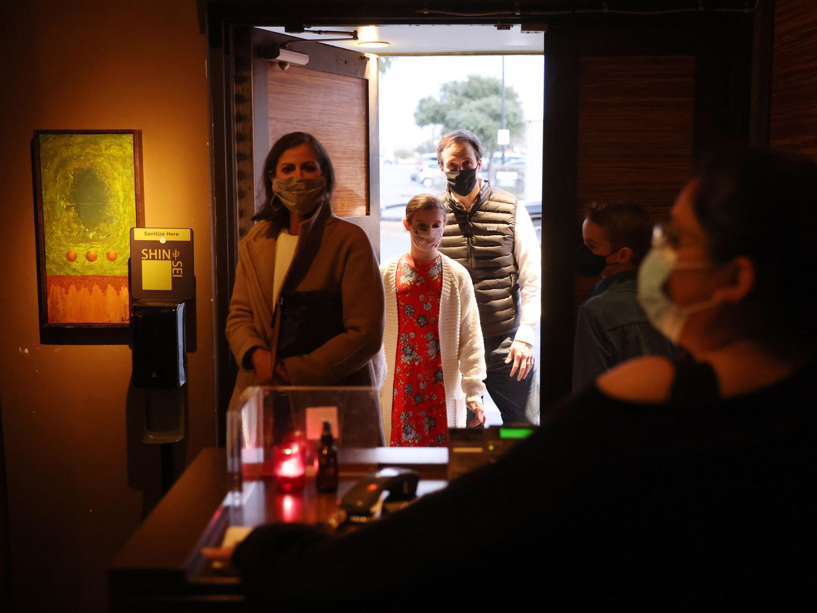 (From l to r) Kelsey Phillips, Saylor Phillips, 10, Chandler Phillips and Ford Phillips, 11, prepare to check in with Daniela Vazquez as they make their way inside Shinsei Restaurant to celebrate Ford's birthday on Tuesday, January 26, 2021 in Dallas.