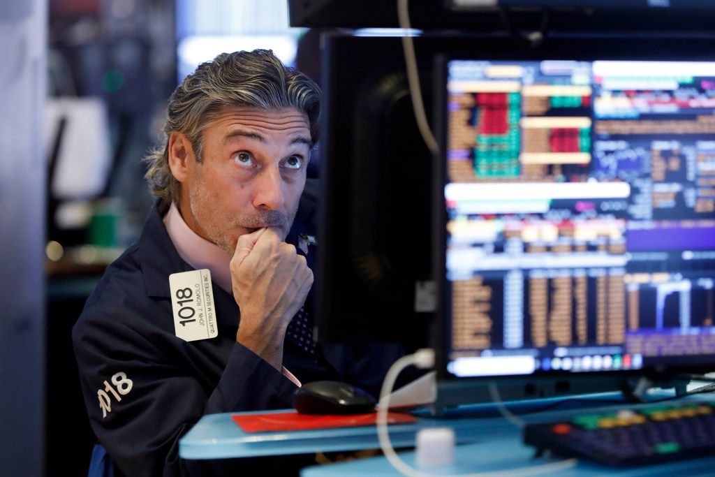 Trader John Romolo works on the floor of the New York Stock Exchange on Wednesday.