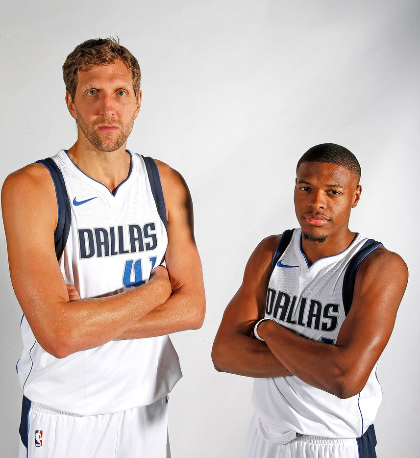 Mavericks forward Dirk Nowitzki (left) and guard Dennis Smith Jr. pose for a photograph during the media day at American Airlines Center in Dallas, Monday, Sept. 25, 2017. (Jae S. Lee/The Dallas Morning News)