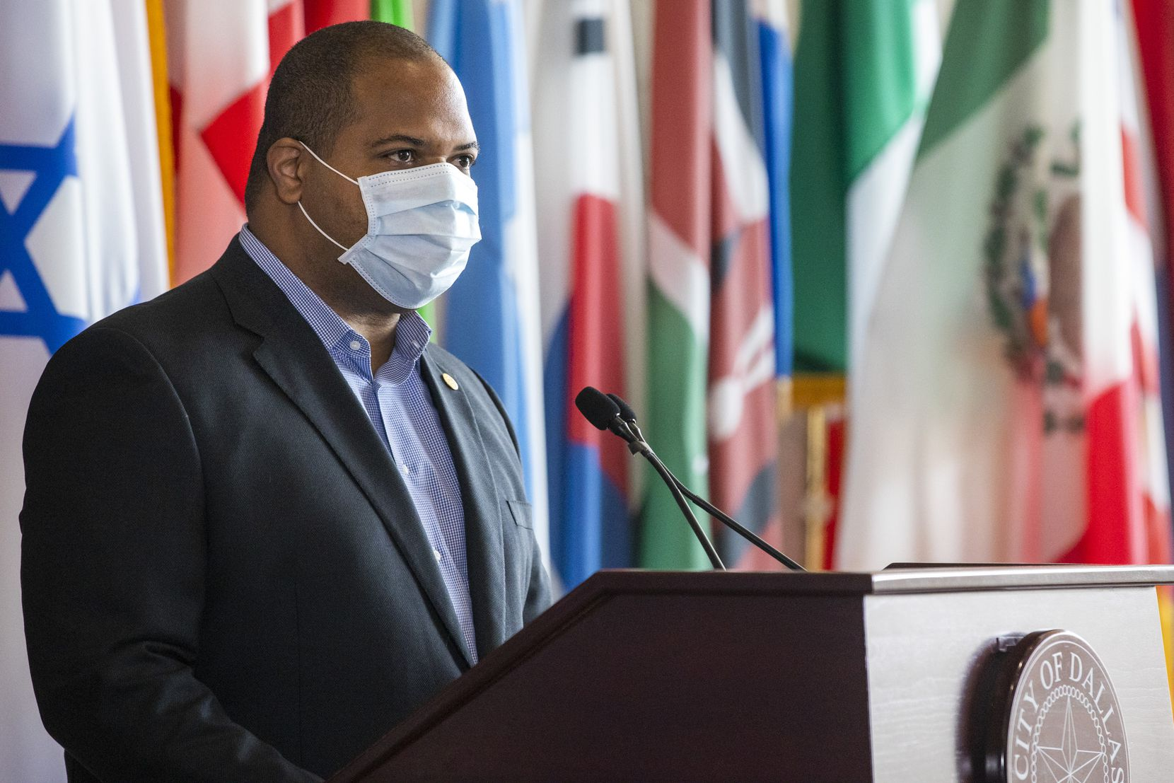 Mayor Eric Johnson names Dr. Kelvin Baggett as the city's new COVID-19 Health and Healthcare Access Czar during a press conference at Dallas City Hall in Dallas on Tuesday, May 12, 2020. Johnson said Baggett will work with the city, county, and hospital systems to recommend ways to improve access to healthcare, testing, and essential services during the COVID-19 pandemic.