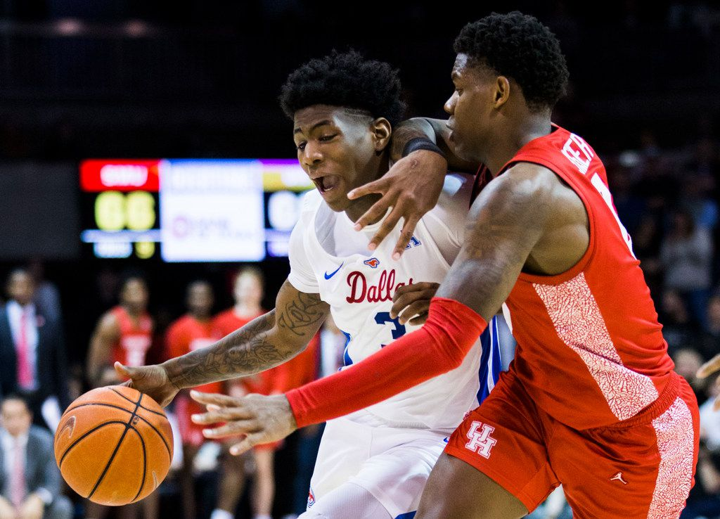Southern Methodist Mustangs guard Kendric Davis (3) is defended by Houston Cougars guard Marcus Sasser (0) during overtime of a basketball game between SMU and University of Houston on Saturday, February 15, 2020 at Moody Coliseum in Dallas. (Ashley Landis/The Dallas Morning News)
