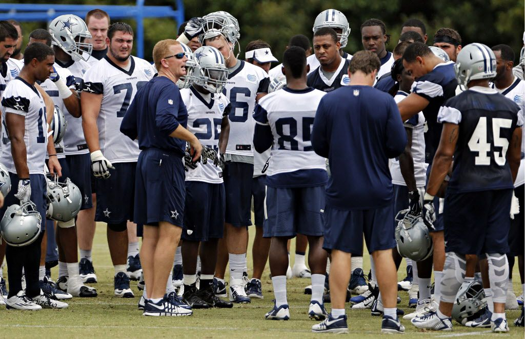 Dallas Cowboys head coach Jason Garrett huddles players during a mini camp Tuesday, June 16, 2015 at the team's Valley Ranch practice facility in Irving, Texas. (G.J. McCarthy/The Dallas Morning News)